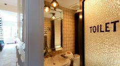 Love the window in the bathroom door. So cool!