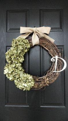 grapevine wreath with hydrangeas and burlap