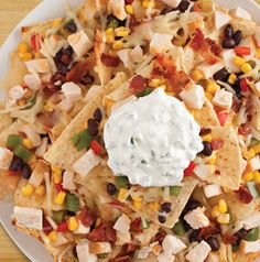 Everything Chicken Nachos for a graduation party? Why not? Make smaller platters and scatter them around the room.