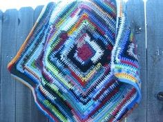 Crazy Lady Throw - Made with reclaimed yarn and scraps of craziness. #crochet #reclaimed