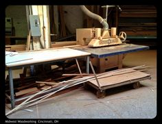 Power fed rip-saw. Table top is 8' long.