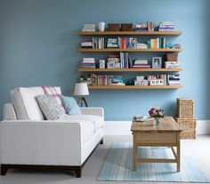 "Can't find a shelving unit you like? Consider creating a ""bookcase"" out of several matching floating shelves. realsimple.com"