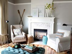 @The Inspired Room on bringing blue accents into your home with paint & subtle accessories. Via MyColortopia.com chair, grey walls, furniture arrangement, living rooms, fireplac, blue, color, paint, live room