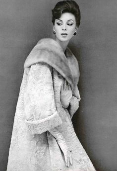Wilhelmina in beige broadtail coat with mink shawl collar by Jessel, photo by Guy Arsac, 1960