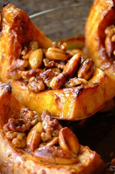 Honey and Thyme Roasted Squash. The butternut squash is roasted and topped with sweet sticky nuts. #thanksgiving