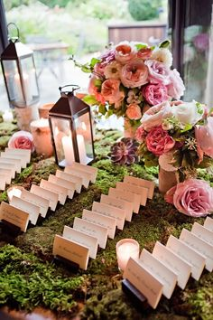 Enchanted garden, green moss with pink florals for the guest book table