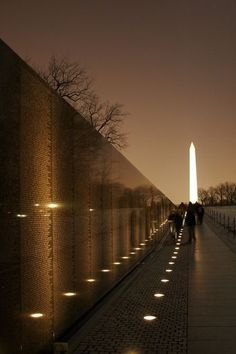 Vietnam Memorial Wall and Monument with the Washington Monument in the background, Washington, D.C.