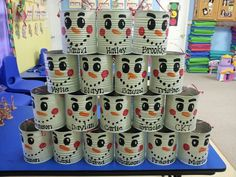 Christmas snowman goody cans...saved #10 cans from our preschool kitchen & painted them to look like snowmen for our kids to carry all their goodies home in :)