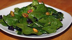Spinach Salad with Pistachios with Mustard Orange Dressing - Elana's Pantry