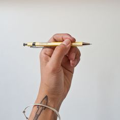 pastel yellow with an eggshell sheen. Delfonics pocket pen at Zakka Shop