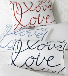 "Love Accent Pillow    ""Love"" embroidered in Lulu's freehand letters comes together in Lulu DK Matouk's Love Accent Pillow. Available in Red, White, Ocean, Navy and Ivory."