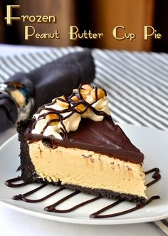 Frozen Peanut Butter Cup Pie - a chocolate cookie crumb crust gets filled with a no-churn peanut butter ice cream then topped with a soft, melt-in-your-mouth chocolate ganache and finally garnished with vanilla whipped cream and roasted peanuts. Easy to make and incredibly delicious.