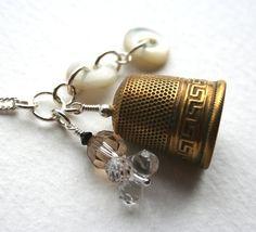 Greek Key pattern thimble charm necklace.