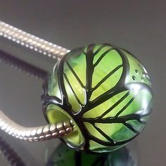 Pikalda :handmade lampwork 1 glass charm bead big hole-flower blossom-'Spring Leaves'-SRA-make to order. $20.00, via Etsy.