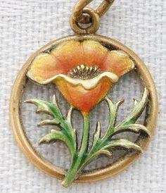 Vintage gold enameled poppy charm
