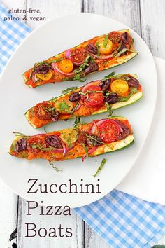 Zucchini Pizza Boats - zucchini, marinara or pizza sauce, nutritional yeast (optional), red onion, kalmata olives, cherry tomatoes, fresh basil chiffonade