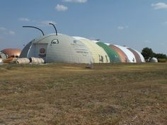 This is Bruco, whose name is the Italian word for caterpillar, our manufacturing plant in Italy, Texas. We cool this sprawling facility with a 5-ton AC unit, and in cold weather, we heat it just by leaving the lights on all night. Note: Domes look half as big from the outside as they do from the the inside. — www.monolithic.com
