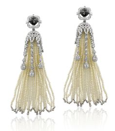 Pearl and Black Diamond Earrings by Yael Designs via Grace Ormonde. At First Glance they reminded me of Dancing Flowers from Disney's Fantasia. Pretty!