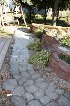 Walled pond. Love the faux stone path.