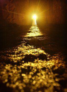 The rays of the winter solstice sun rise illuminate the interior of the Neolithic passage tomb at Newgrange, Ireland