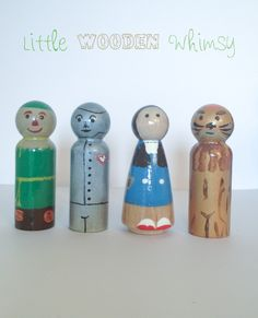 """4 piece Wizard of Oz peg doll set, hand painted and glazed with a non-toxic brush on gloss. XL size pegs, measuring 2.5"""" Standard size pegs also available ($20 for set made with standard pegs)"""