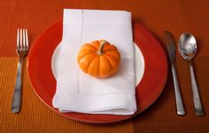 Add mini pumpkins to each place setting to effortlessly dress up your table for the season.
