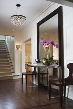 Loving the height and simplicity of frame in the hallway mirror... it really contemparises an otherwise quite traditional hallway.. entry hallway, modern mirror, entrance decor, glamour interior design, modern entrance hallway, interior design hallways, foyer mirror, hallway mirrors, decor entrance