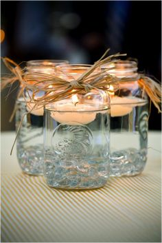 bridal shower country theme   Love the feel and look of these floating candle centerpieces! We can add glow stick liquid to the water sparkles that are the theme colors.