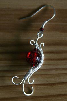 perlas de vidrio y pendientes de plata de alambre