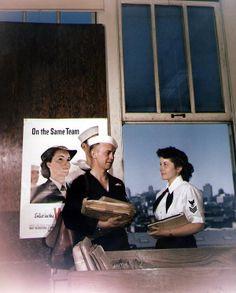 US Navy Mailman 2nd Class Wilbur L. Harrison and Yeoman 1st Class Marjorie Daw Adams at Fleet Post Office, San Francisco, California, 13 June 1945 (US National Archives)