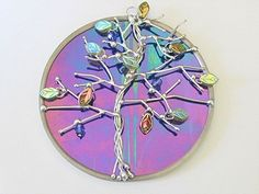 Tree of Life Stained Glass Suncatcher or Wall Decor Cobalt Blue Iridescent. $30.00, via Etsy.