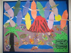 Dinosaur bulletin board; marble painted dinosaur eggs and wall paper pterodactyls.