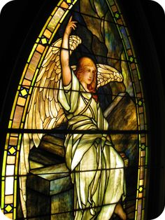 Angel stained glass window by Louis Tiffany.