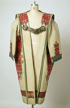 Szur (Hungarian coat) -- embroidered, appliqued -- .  Men were proud to wear these -- they were highly coveted.
