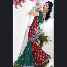 Beautiful Lush Red & Teal Blue Embroidered Saree.    Color: Red, Teal Blue  Fabric: Brasso, Faux Georgette  Work: Bead, Lace, Resham And Sequins Work.
