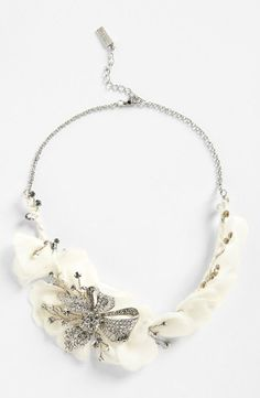 Floral statement necklace of silk-organza petals and crystals
