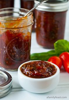 Homemade Tomato Jam - A delicious sweet and savory tomato jam recipe - perfect for using up summer garden tomatoes!  This is like a chunky gourmet ketchup - only so much better!