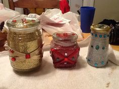 "3 ""Wise Men"" gifts...  Instructions: Wash out old jars (candle jars and jelly jars work great!) and dry them thoroughly. Spray the inside with spray adhesive. Pour in glitter of your choice, put the lid on and shake it up!!  Add ribbon, gem stones, and other accessories as you please. I simply used a hot glue gun and  knick-knacks I found on my craft shelf! I actually didn't spend any money..all these supplies were in my basement, but the project is under $10 if you have to buy the supplies!!"