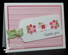 Light pink paper was run through an embossing folder to create a background of scallops.  A white tag tied with a Pear Pizzazz Chevron ribbon holds 3 small petite petals, in alternating shades of pink.  DIY Thank You card.