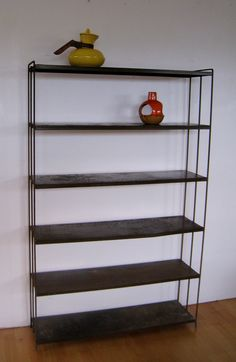 Great find. Mid Century modern Industrial Paul McCobb era metal bookshelf. $165.00, via Etsy.