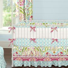 Kumari Garden Crib Bedding   Girl Nursery Bedding   Carousel Designs.  This bright and fun collection is inspired by the colors of India. The mixture of colors and prints in shades of teals, aqua and fuchsia create a whimsical touch to a modern design. The triple tier skirt is the perfect way to add that special touch to your nursery decor.