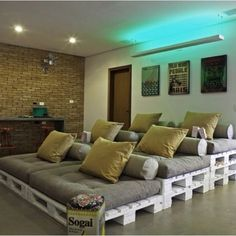 Movie Room with pallet beds... So cozy!