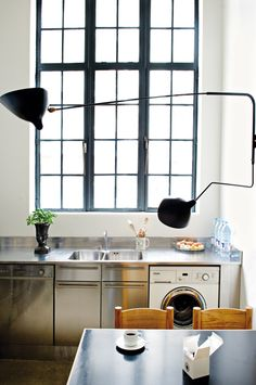 stainless steel cabinets, windows, Serge Mouille light
