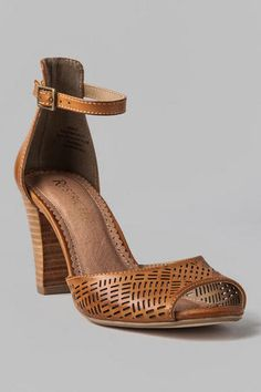 Need to add a bit of vintage, casual sophistication to a look? Then grab the Downtown Cutout Heel with an open toe, ankle strap, cupped heel, and faux stacked heel. In a rich tan the Downtown Cutout Heel will complement a printed dress with a kimono wrap