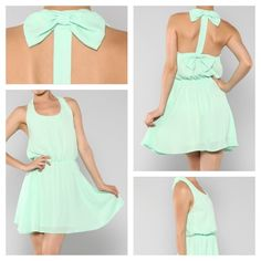 The+Mia+is+mint,+chiffon+halter-dress+featuring+flirty+bows+above+and+below+the+shoulder+line,+a+cinched+waist+and+flows+out+above+the+knee+for+a+romantic+look.+Pull+your+hair+into+a+loose+updo+making+sure+to+leave+a+few+strategically-placed+strands+around+your+face+and+pair+with+nude+heels+and+g...