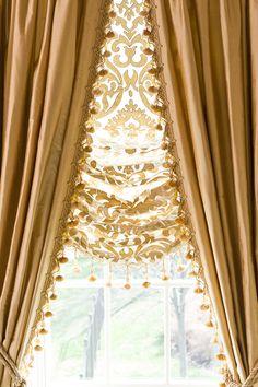 Custom window treatments... lots of ideas on this site.