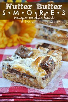 Nutter Butter Smores Magic Bars on www.somethingswanky.com #recipes #dessert