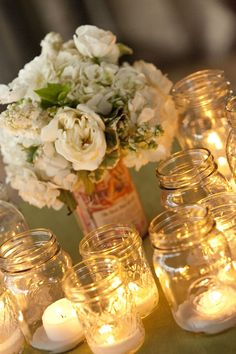 Mason jars with tealight candles inside. Allyson Magda Photography. Wedding Coordination by All Traditions.
