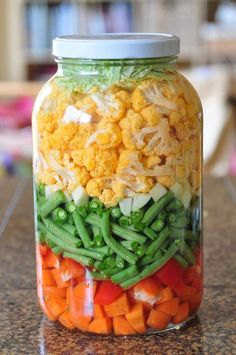 Just finished making a gallon of lacto-fermented vegetables. Now we just need to wait a week for the bacteria to do their thing. This batch has carrots, red bell peppers, green beans, garlic, and cauliflower. To learn how to make them yourself, follow this post and video: http://www.nourishingmeals.com/2012/02/how-to-make-lacto-fermented-vegetables.html