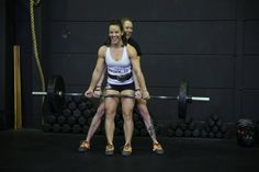 Sam Briggs and Camille Leblanc-Bazinet practicing pair deadlifts before the 2013 CrossFit Invitational.